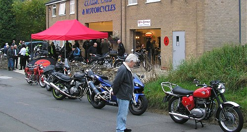 Distracted by the shiny red BSA, Ted missed the best of the cakes available inside...