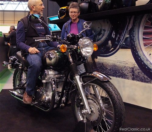 She's smiling, because she's seen the seat on the Honda VT750S...