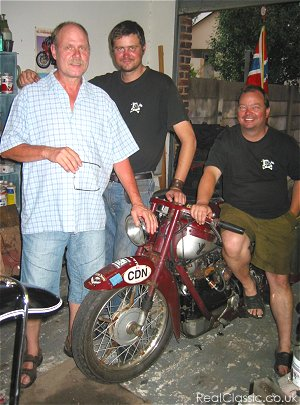 Pierre Cronje (left), chairman of the Classic Motorcycle Club, see with the Norwegian adventurers Tormod Amlien and Klaus Ulvestad (seated)...