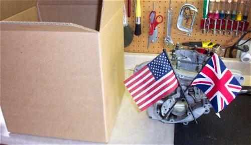 Crankcase and cardboard box united in transatlantic harmony.