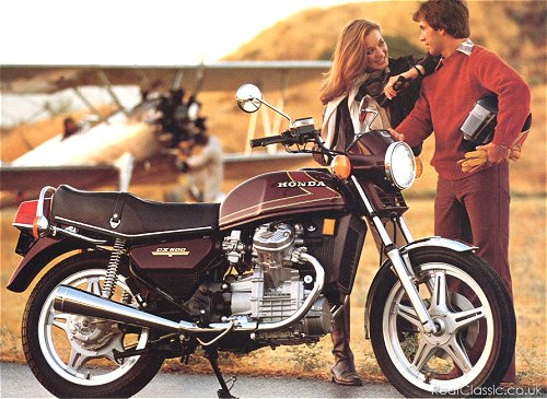 What a brown photo. Brown jumper, brown slacks, brown gloves, brown bike. Although everything else looks so brown, the bike might be purple...
