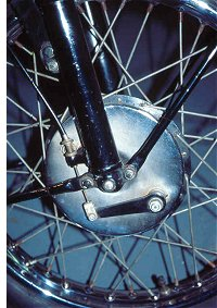 BSA fans will recognise the less than gripping group front brake attached to the group front fork. My, what a stopper, they don't say