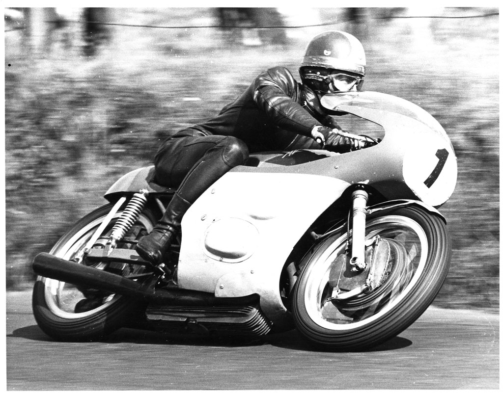 The ultimate and imperious pairing, Giacomo Agostini and the MV Agusta. This is a 350cc version, at the 1968 Ulster GP.