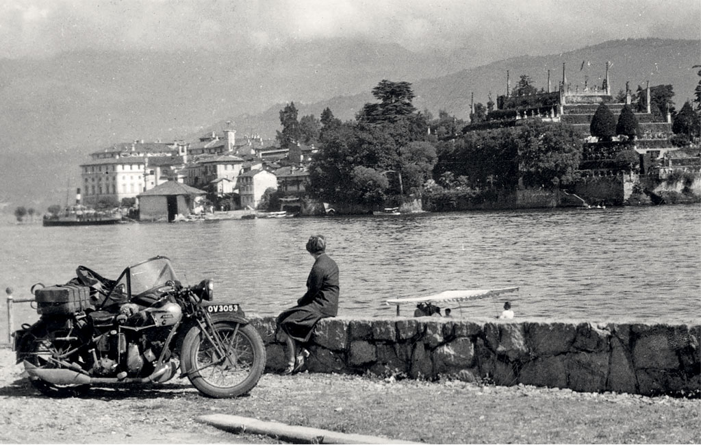 Paused by the side of the road, a 1931 550cc Ariel side-valve 'Sloper' and sidecar, which has ferried The Motor Cycle's correspondent Wharfedale (real name Donald Smith, The Motor Cycle's Northern correspondent) and his wife on a continental trip 'from Manchester to Maggiore'.