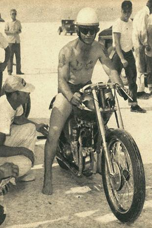 Jack Dale on his Triumph motorcycle wearing the official record-breaker's uniform