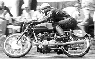 Englishman Cecil Sandford on his way to winning the 1952 Dutch TT on an MV Agusta motorcycle
