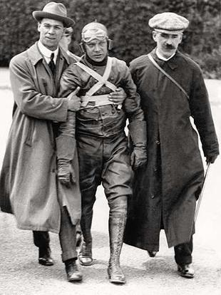 Winner of the 1913 Junior TT, NUT founder High Mason is helped along after his iwnning ride