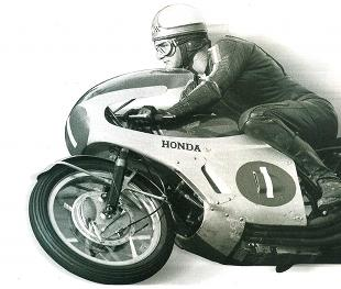 Mike Hailwood on his Honda racing Phil Read