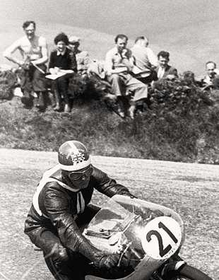 The 1958 Isle of Man 125cc TT, and Miek Hailwood hustles his way to seventh place on the Paton
