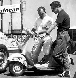Stirling Moss trying a Vespa scooter out for size