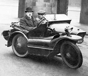 Alfred Angas Scott pilots his Sociable three wheeler in Jnauary 1917