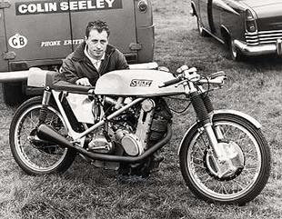 Colin Seeley poses behind his 150cc AJS 7R powered Seeley at Mallory Park in 1968