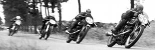 Freddie Frith leads Bob Foster, both on Velocettes, in 1949 Dutch motorcycle TT