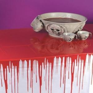 Hey! Stop bleeding on the tablecloth !!