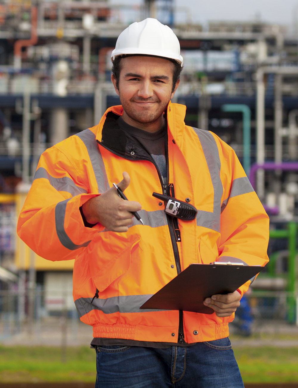 smiling oil and gas worker holding clipboard