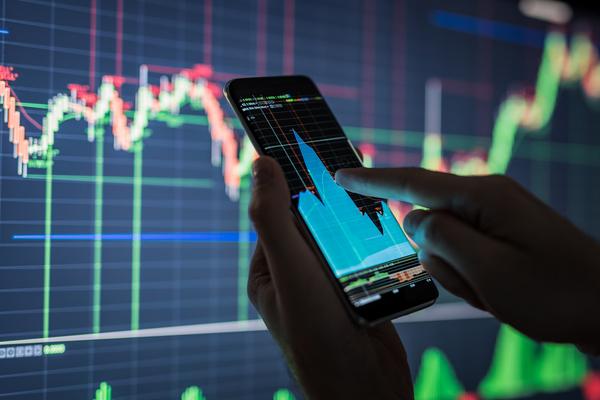 Businessman-checking-stock-market-data.-853584220_1258x838