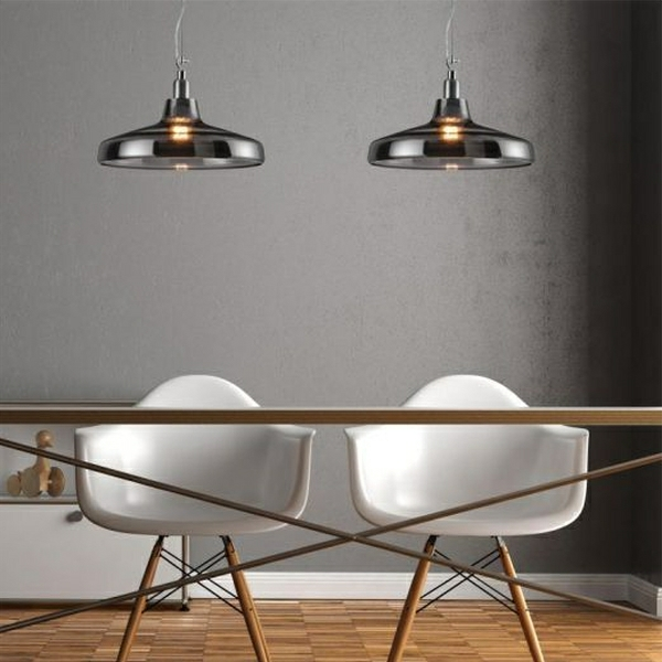 pendant lights over a dining table
