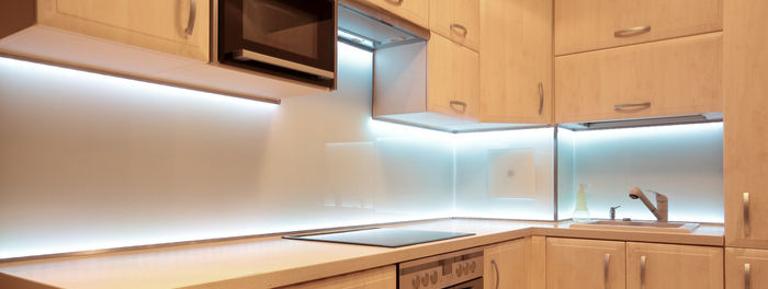 kitchen lit up with led extrusion profiles