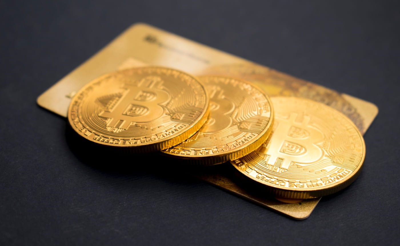 Credit card and bitcoins lying together