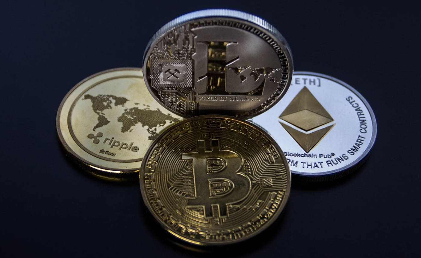 Four types of cryptocurrency presented as metal coins