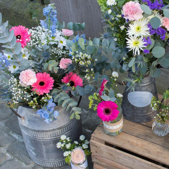 Wedding-flowers-milk-churn-jug-and-jars.jpg