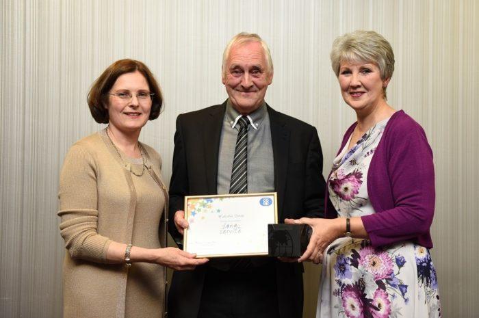 Malcolm-with-long-service-award.JPG
