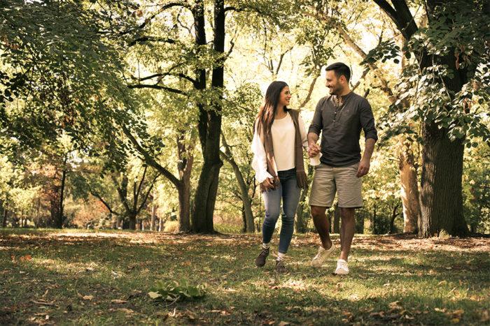 Couple-walking-in-woodland-countryside.jpg