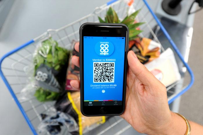Dividend-App-over-shopping-basket-close-up.jpg