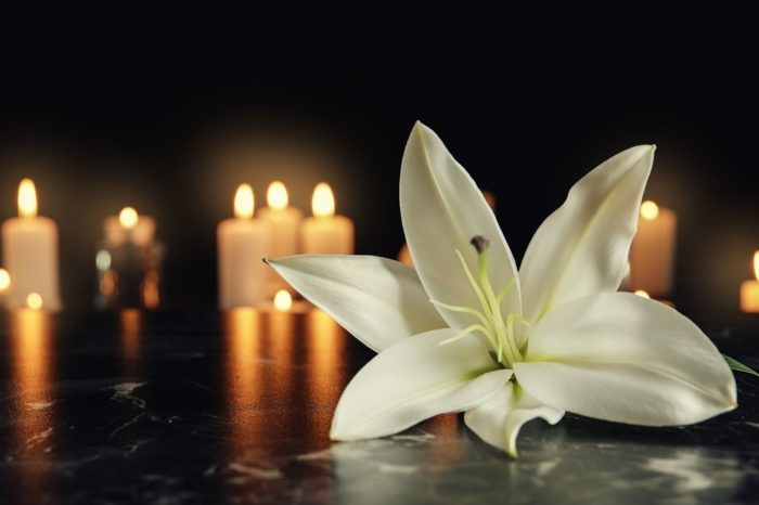 White-lily-and-candles-memorial.jpg