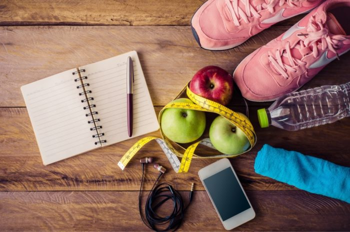 fitness-concept-with-Exercise-Equipment-on-wooden-background.jpg