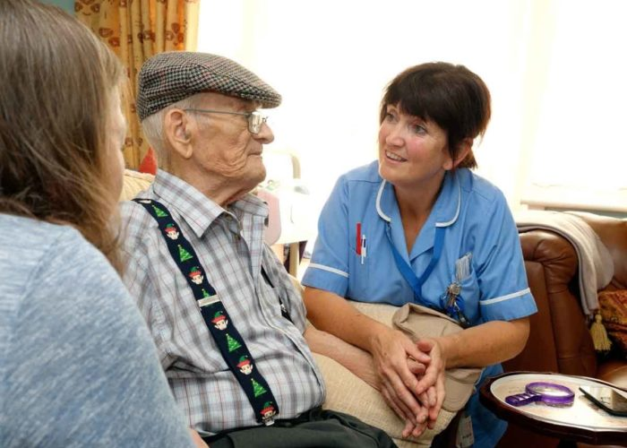 Small Hospice At Home Nurse And Patient