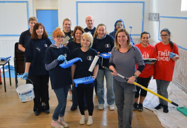 Colleagues go back to school to revamp community hall
