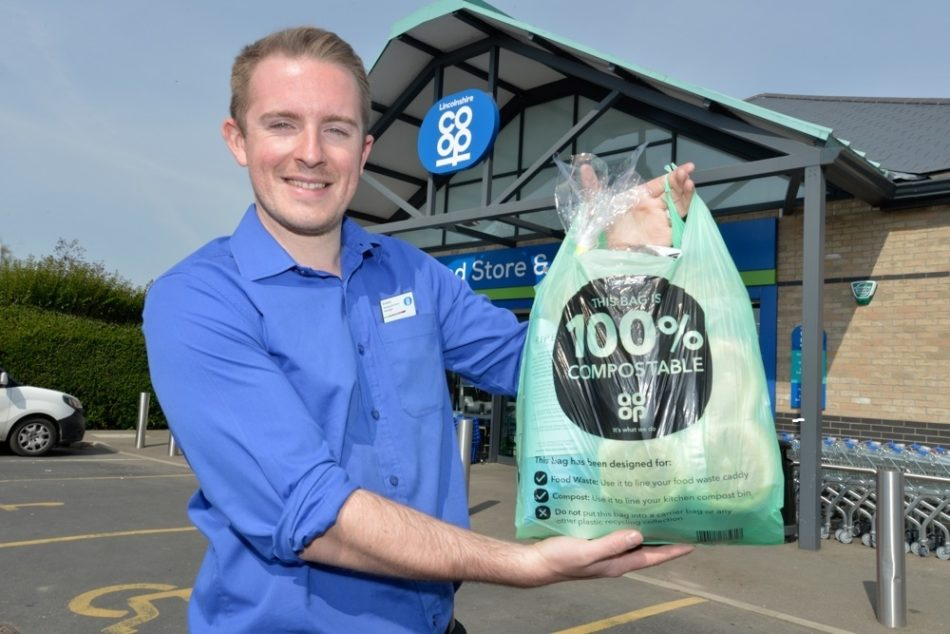 Compostable Carrier Bag Outside With Kristian No Mask 2