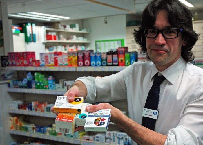 Pharmacist-Manager-Ekaitz-Unanue-holding-hay-fever-medication.jpg