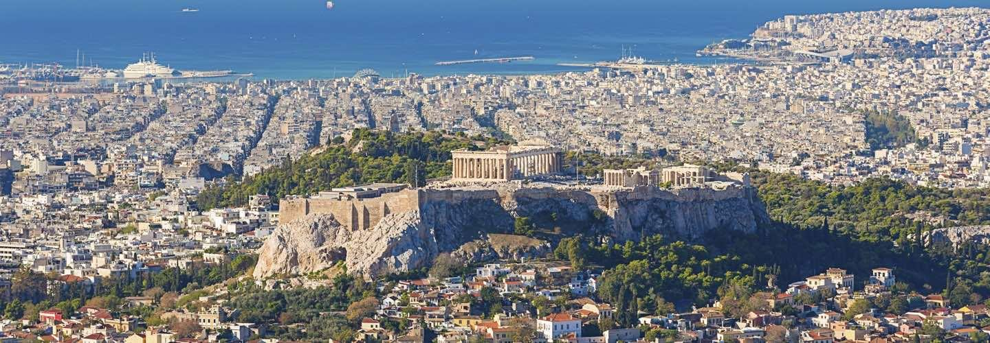 Athens with the Acropolis and its Parthenon with the sea and yachts in the background