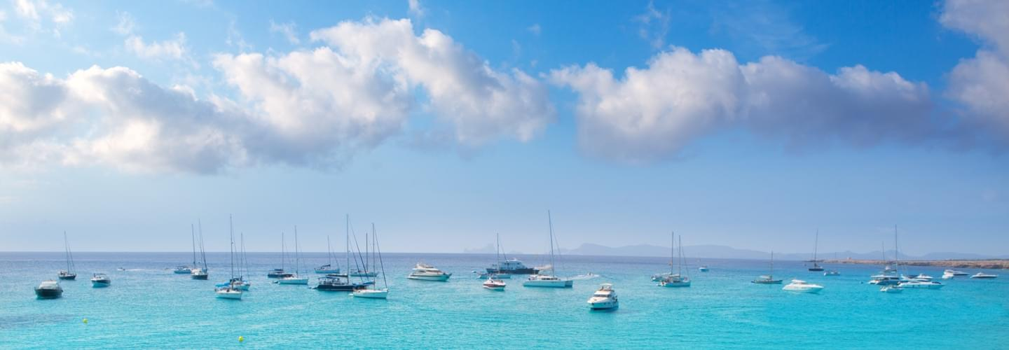 Skyline of boats on the Mediterranean sea near the Baltic island of Formentera in Spain