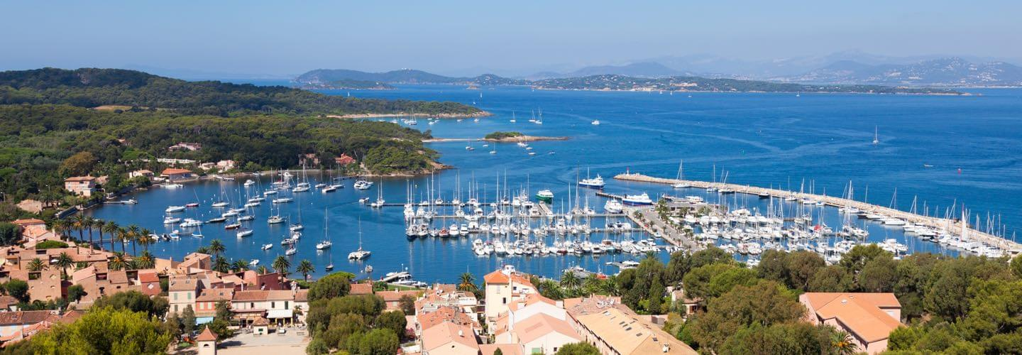 Porquerolles' harbor sunny view next to Hyeres with boats and yachts on the Mediterranean sea