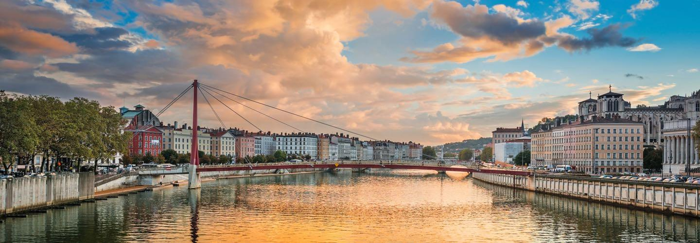 Passerelle du Palais de Justice red bridge on the Saône river in Lyon during sunset