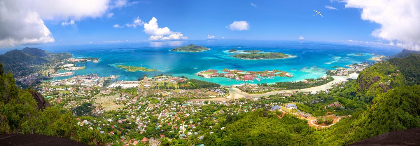 Skyview of Mahe Island in the Seychelles with a clear bleu sky and the Indian Ocean