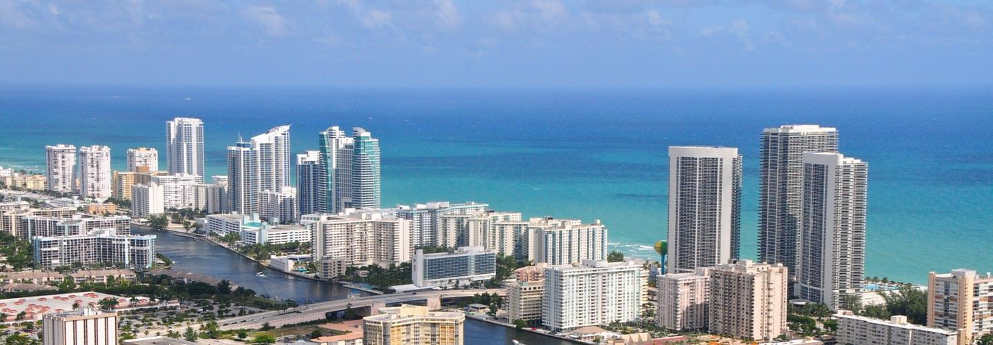Sunny view of Miami West Palm Beach with skyscrapers and the sea and Collins canal