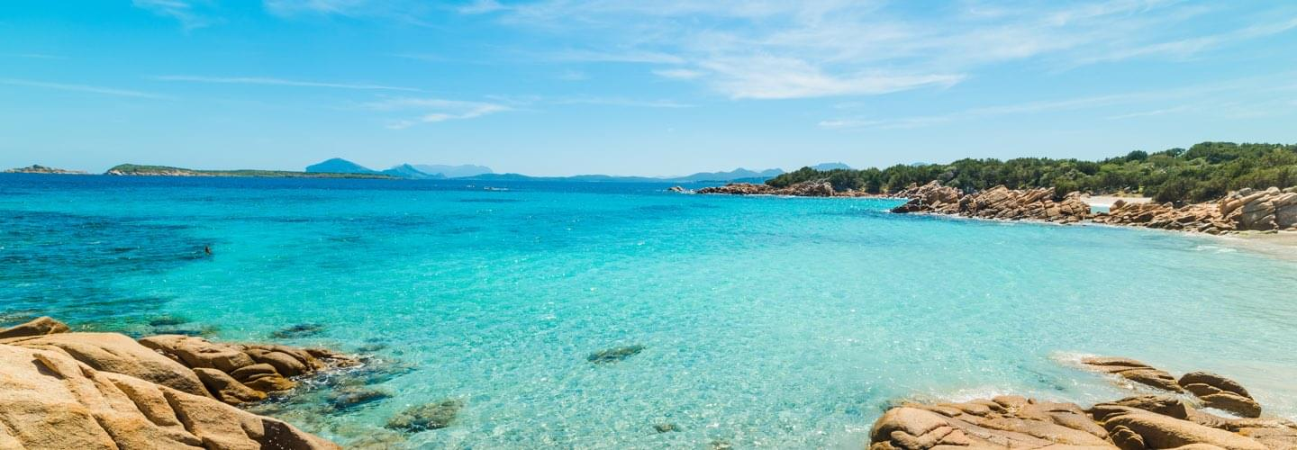 Costa Esmeralda in Olbia with a clear transparent turquoise water in a peaceful sunny summer day