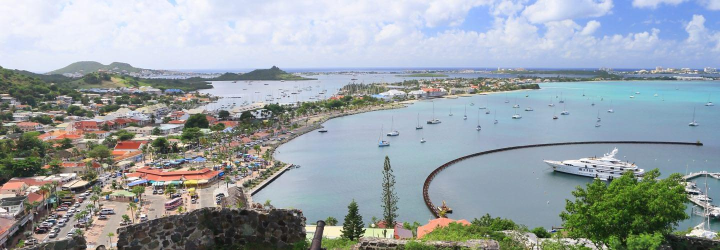 View from the Island of St Martin port with a yacht and boats and Carribean Sea
