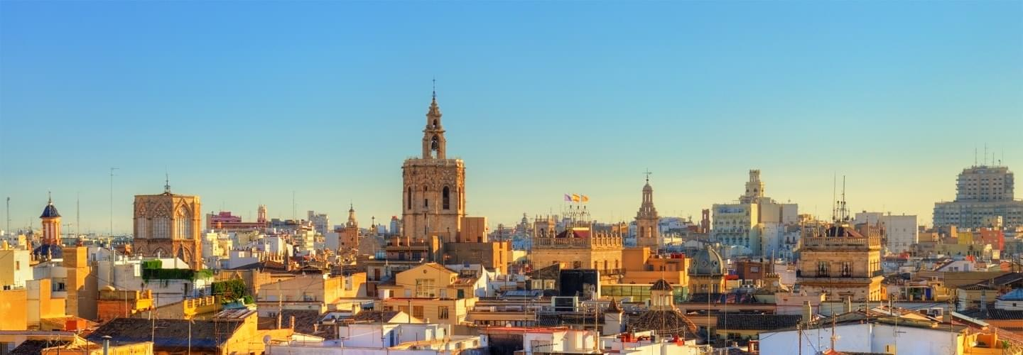 Sunset skyline of Valencia in Spain with a focus on the tower of the Valencia cathedral