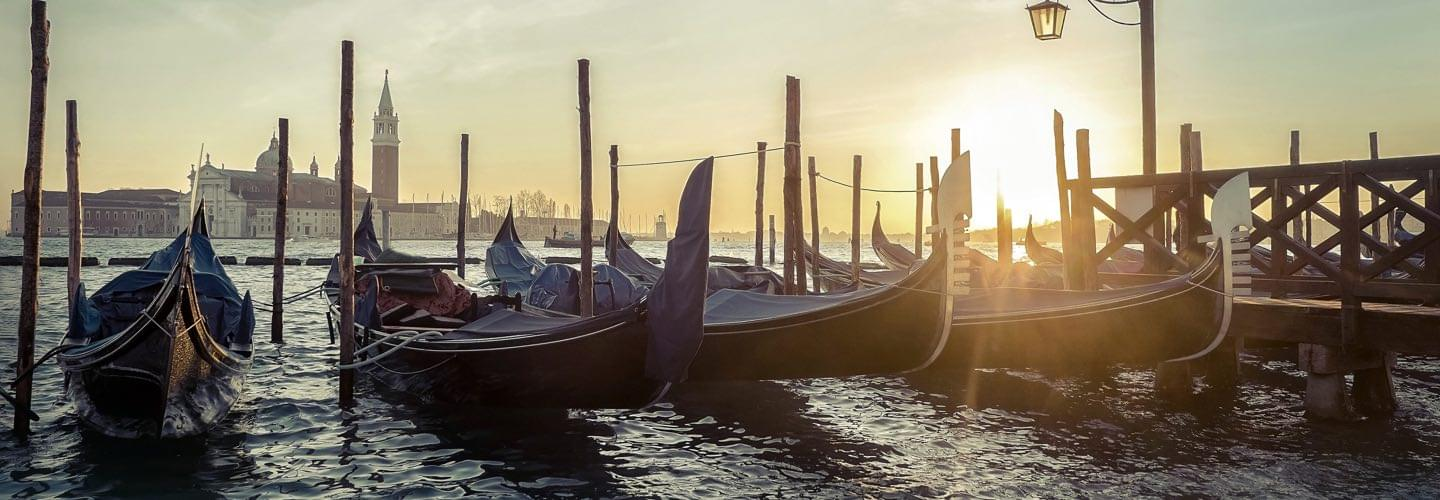 Sunny view of four gondola in Venice with the Palazzo Ducale in the background