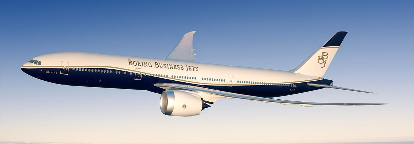 White and blue Boeing Business Jet flying in a clear bleu sunny sky