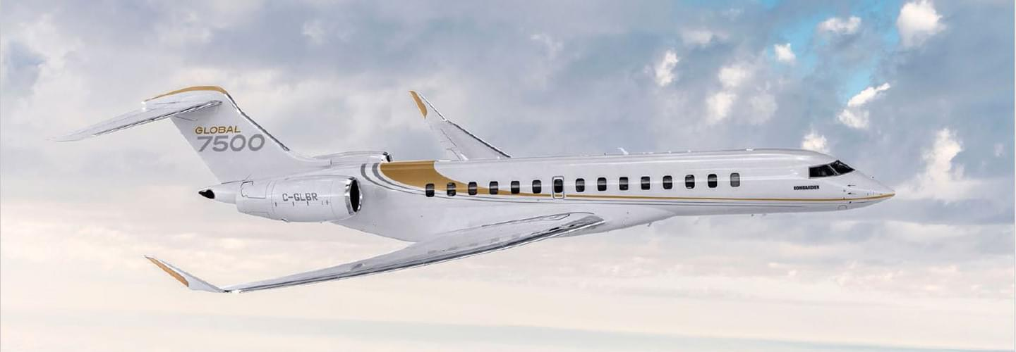 Right side of the Bombardier Global 7500 in white with golden stripes flying over clouds