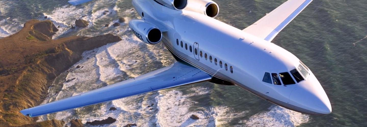 Super Large Business Jet Dassault Falcon 900EX to charter for private aviation flights with LunaJets, upgraded engines, greater fuel capacity