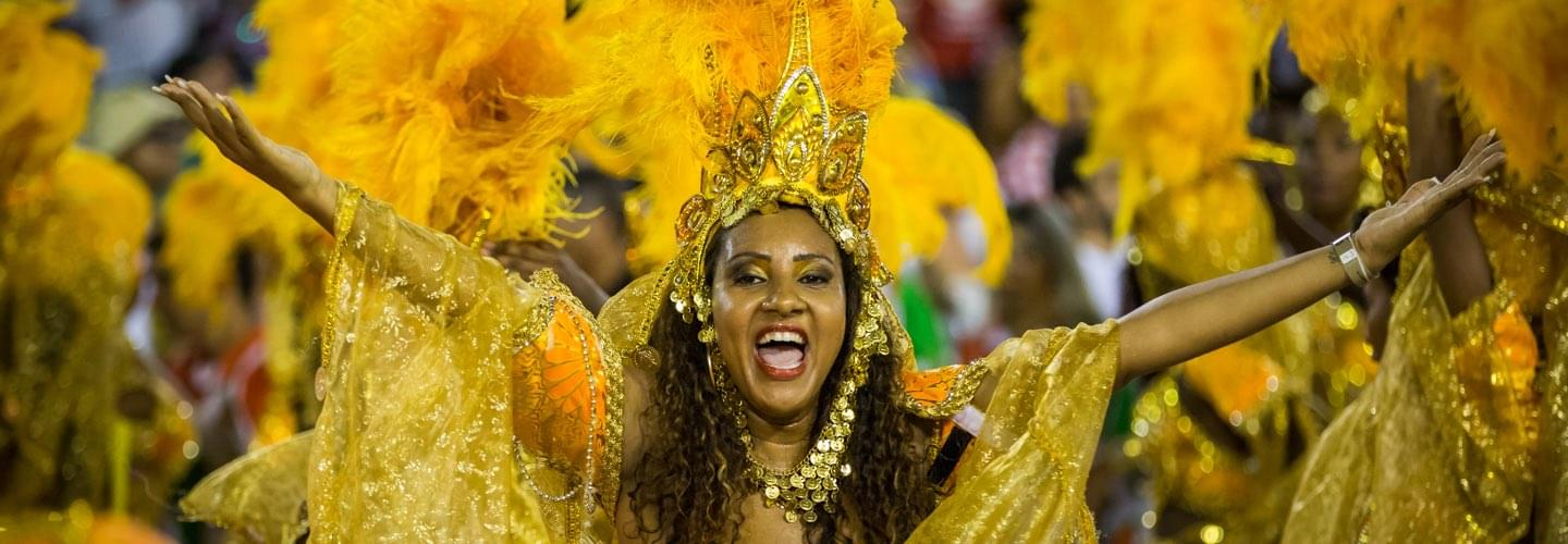 Brazilian woman with a golden feather headgear during the carnival in Rio de Janeiro in Brazil