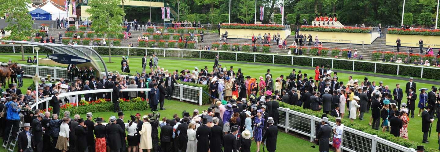 Well-dressed women and men at the Royal Ascot Horse Racecourse Berkshire next to London