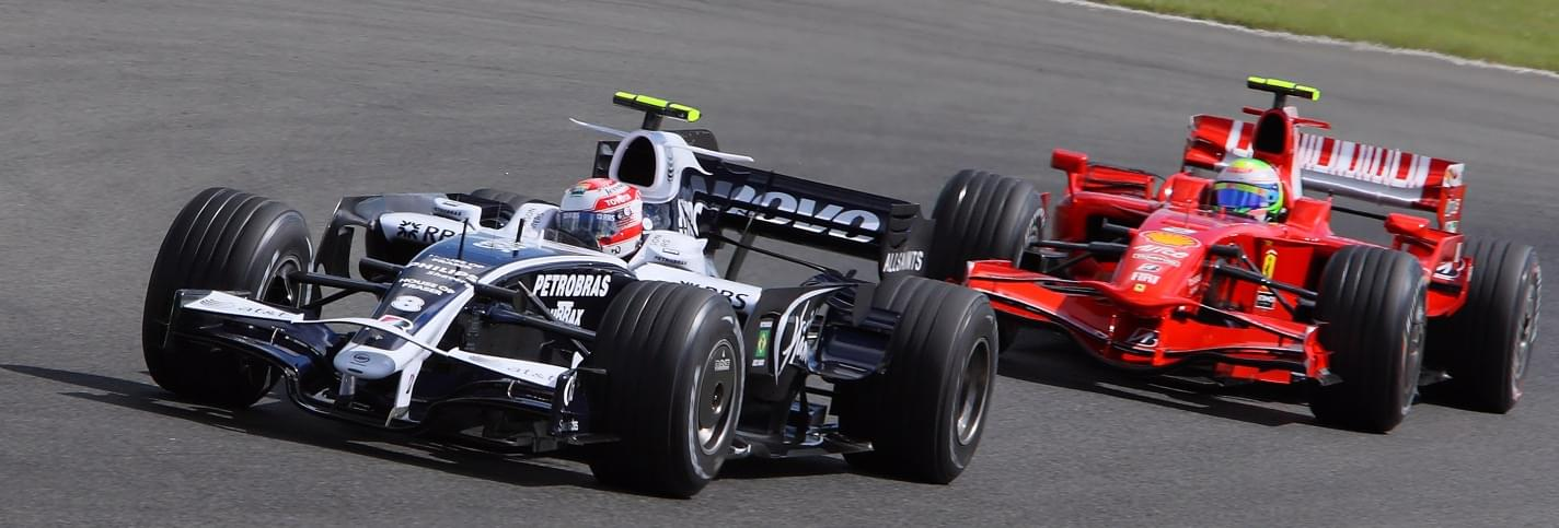 Black racing car followed by a red Ferrari at the Russian Formula 1 Grand Prix Sotchi